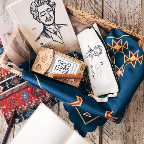 a custom made giftbox comprising of a sketchbook, pencil case, and tea, all themed in Azeri.